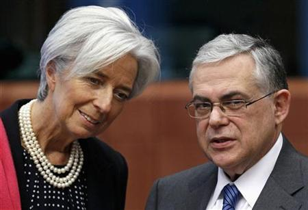 IMF Managing Director Lagarde talks with Greece's Prime Minister Papademos at the start of a Eurogroup meeting in Brussels