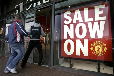 File photo of people walking into the Manchester United Megastore at Old Trafford Manchester.
