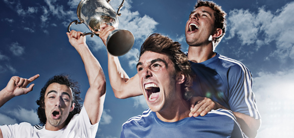 Soccer-players-cheering-with-trophy_pan_13872
