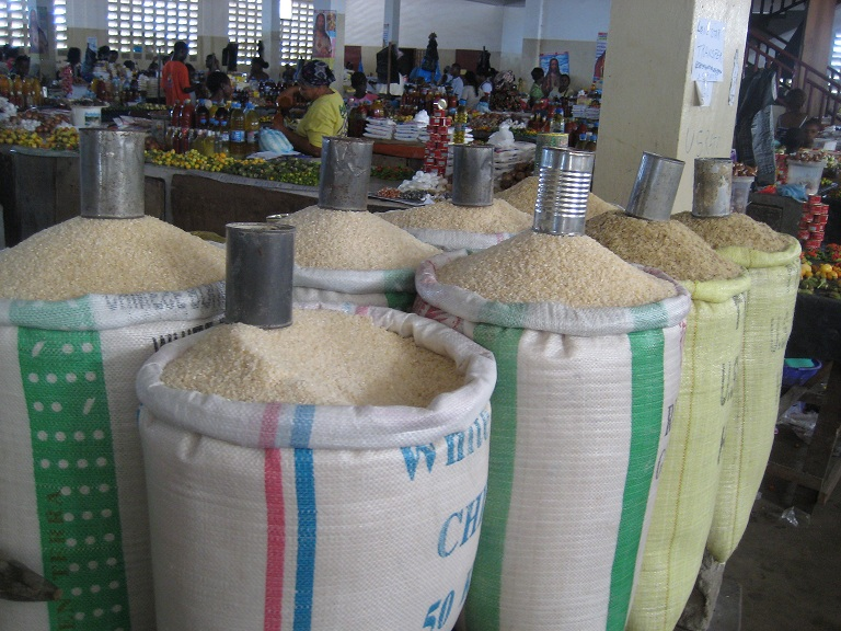 bags of rice being sold by the cup